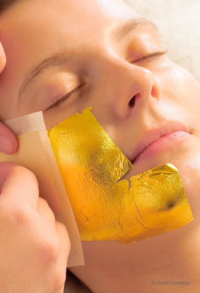 facial treatment with cosmetic gold