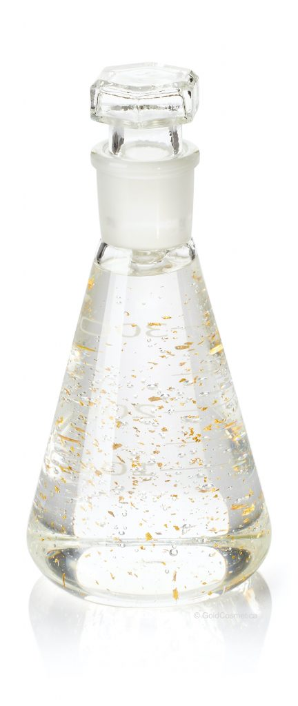 Erlenmeyer flask with serum and gold flakes